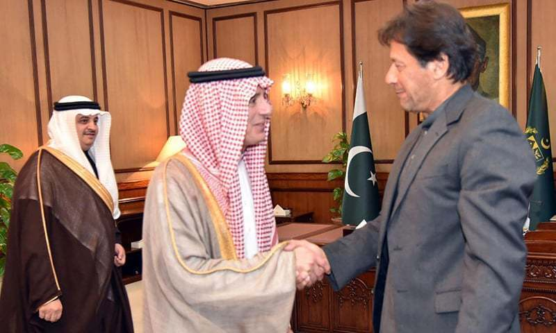 Saudi State Minister for Foreign Affairs Adel al-Jubeir is greeted by Prime Minister Imran Khan at the Prime Minister's Office.
