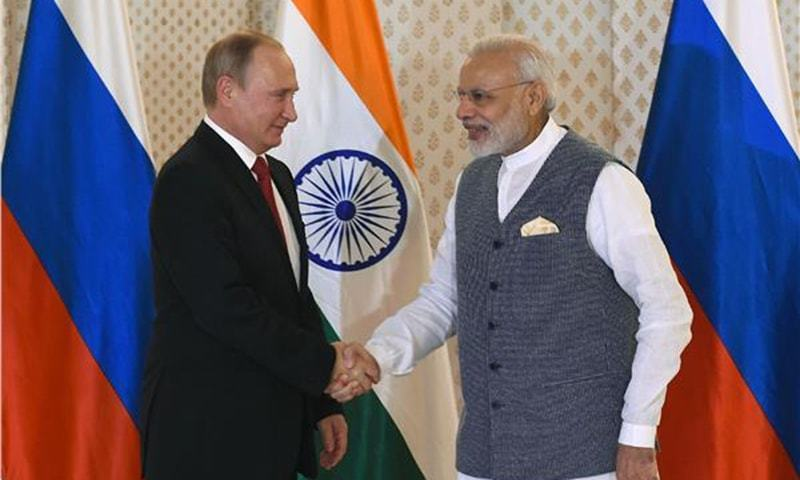 Russian President Vladimir Putin shakes hands with Indian PM Narendra Modi ahead of Indo-Russia Annual Summit in 2016. — AFP/File