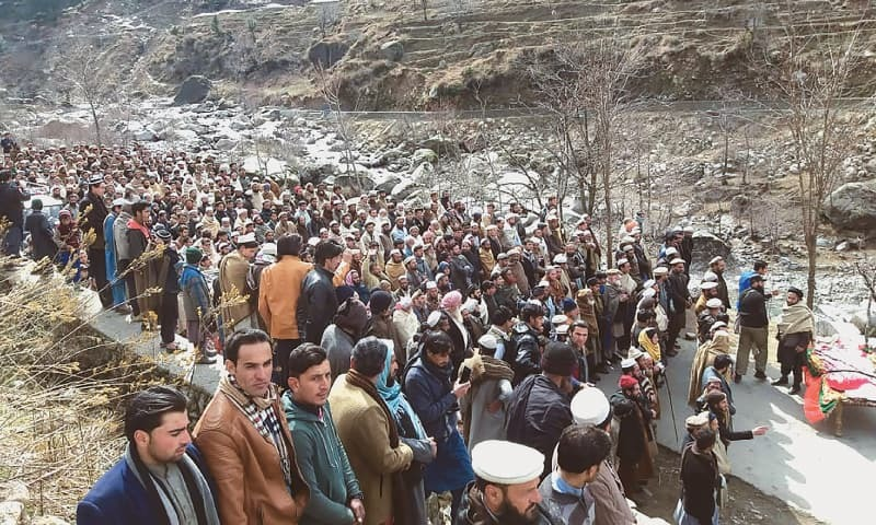 Residents offer funeral prayers beside the coffin of Afzal Kohistani in Battagram district on Friday.—AFP