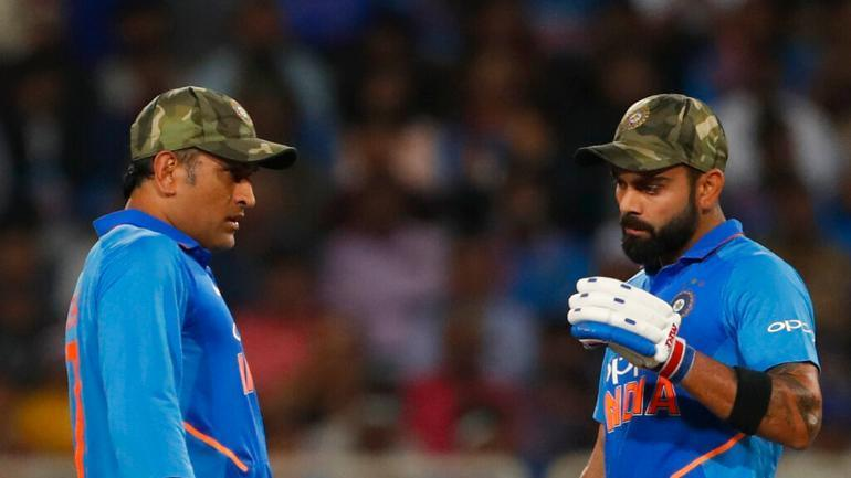 Indian cricket team members are seen wearing camouflage army caps during the third ODI match between India and Australia at the Jharkhand State Cricket Association International Cricket Stadium, in Ranchi. — AP