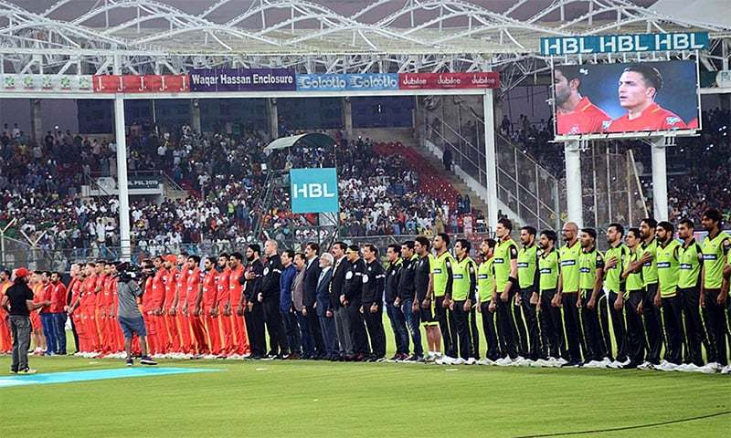 Sindh Chief Minister Syed Murad Ali Shah along with PCB Chairman Ehsan Mani and officials and players of Lahore Qalandars and Islamabad United teams standing as the National Anthem is played before the start of the match. — APP/File