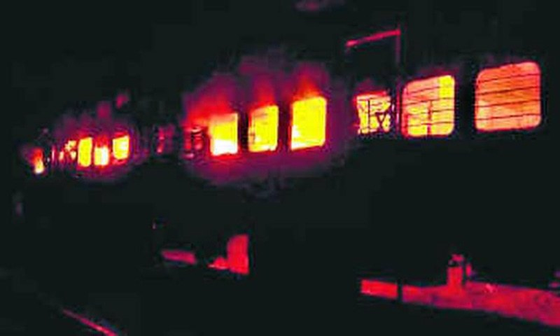 A file photo of the Samjhauta Express in flames after it was hit by blasts near Panipat, Haryana, on February 18, 2007. — AP/File