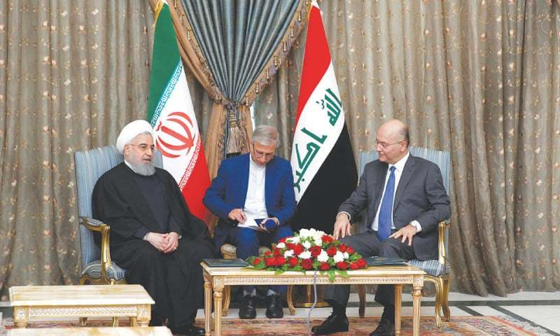 Baghdad: Iraq's President Barham Salih meets his Iranian counterpart Hassan Rouhani at Salam Palace on Monday. —Reuters