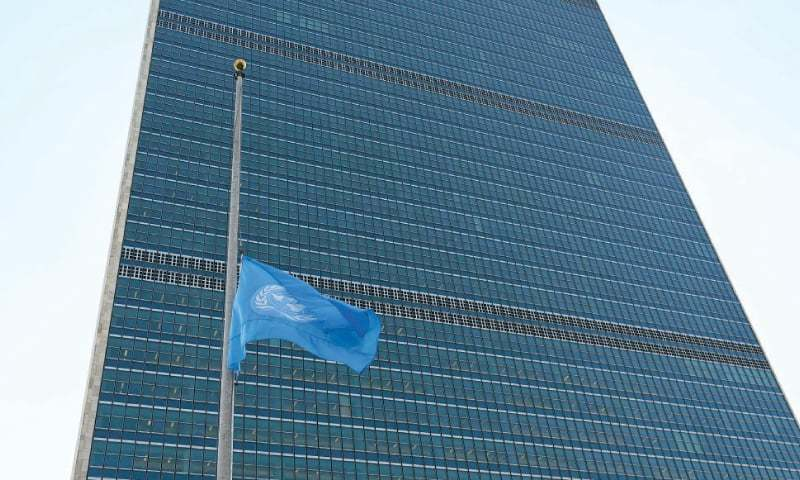 The flag of the United Nations flies at half-mast in front of the secretariat on Monday.—AFP