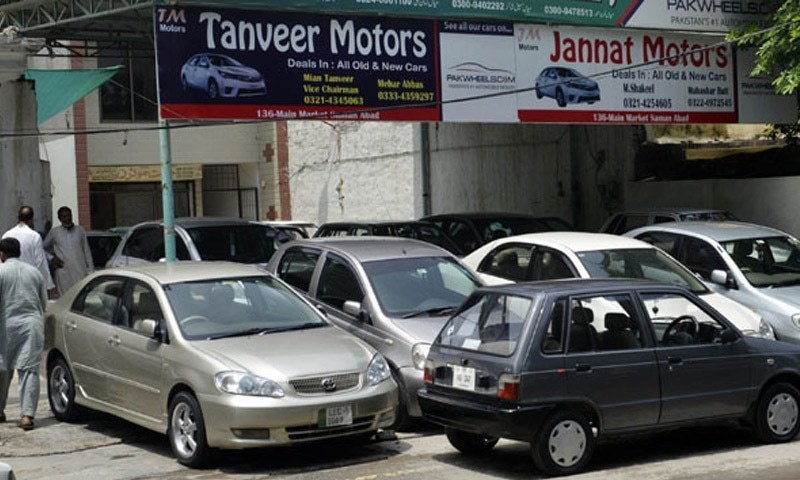 Cars on display outside a showroom in Lahore in this photo.—AFP/File