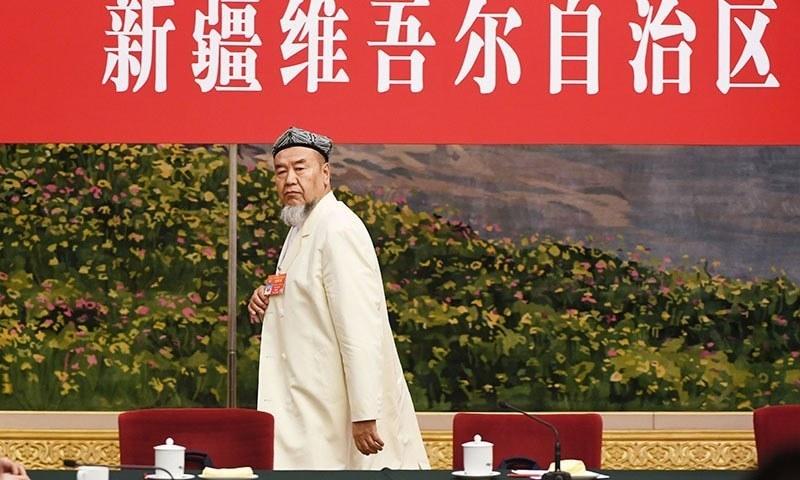 تربیتی مراکز میں لوگوں کی تعداد سے متعلق سنسنی پھیلائی گئی،چینی عہدیدار— فوٹو : اے ایف پی