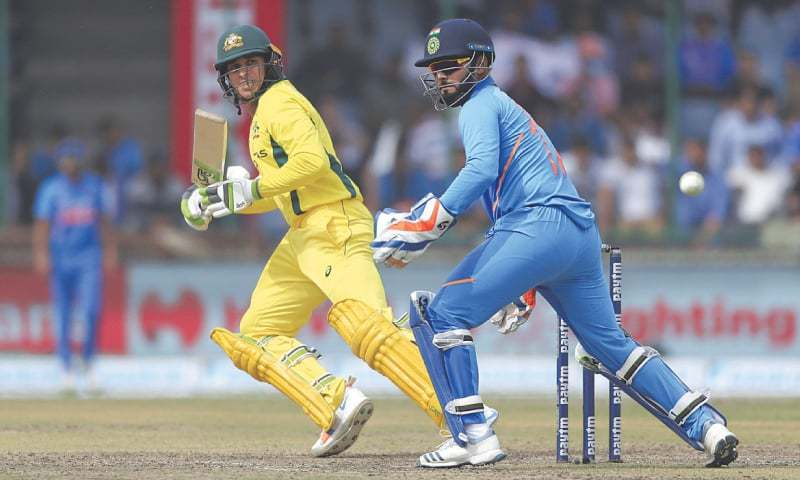 NEW DELHI: Australian opener Usman Khawaja guides a shot past Indian wicket-keeper Rishabh Pant during the final ODI  on Wednesday.—AP