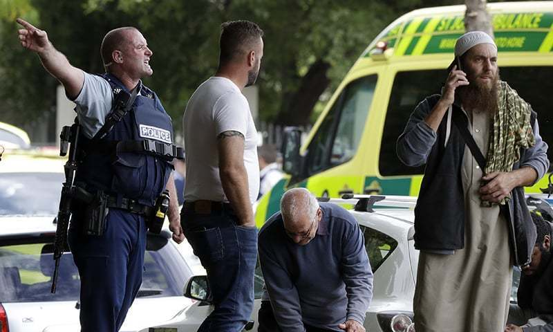 Police attempt to clear people from outside a mosque in central Christchurch, New Zealand, Friday, March 15, 2019. — AP