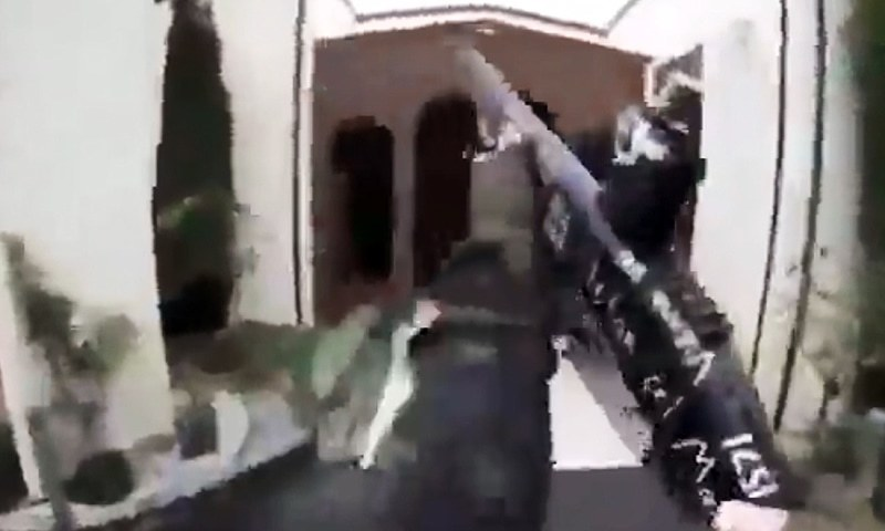 This image grab from a self-shot video that was streamed on Facebook Live on Friday by the man who was involved in two mosque shootings in Christchurch shows the man holding a gun as he enters the Masjid al Noor mosque. — AFP