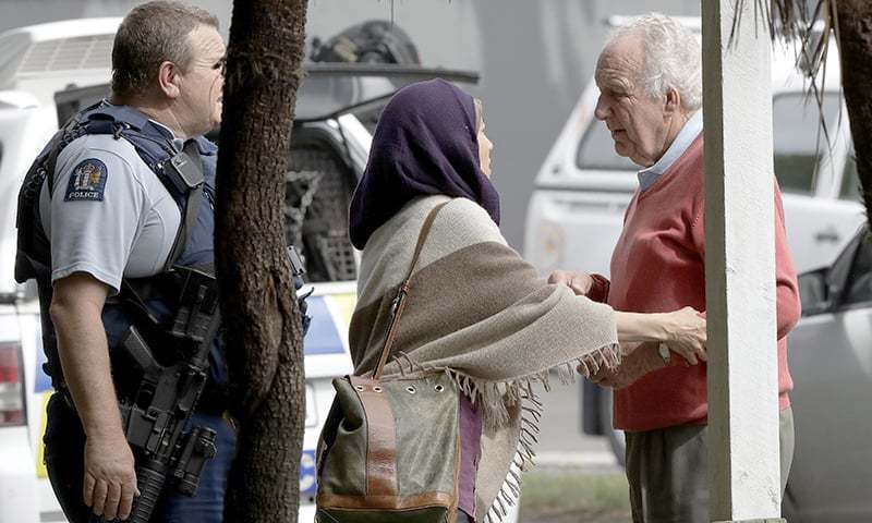 A woman is seen comforting a man as police escort people away from outside a mosque in central Christchurch, New Zealand, Friday, March 15, 2019. — AP