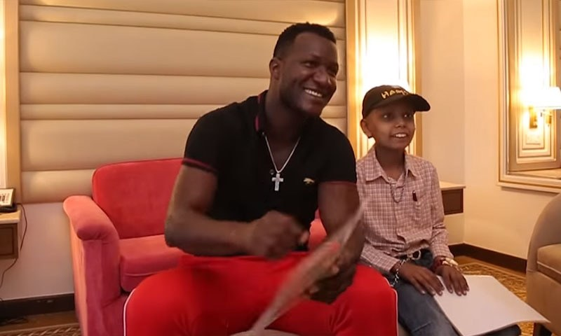 In this screenshot taken from a video uploaded on Zalmi TV's YouTube channel, Sammy meets his young fan. — Zalmi TV YouTube