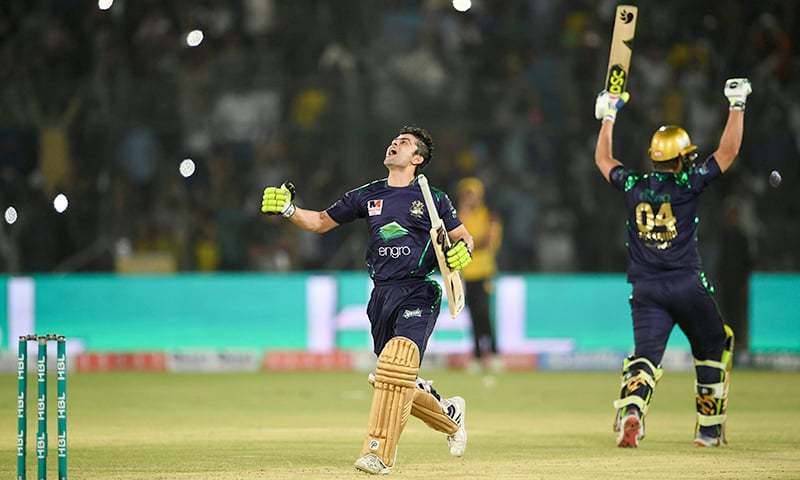 Ahmad Shahzad (L) celebrates the Gladiators' victory in the final of  the Pakistan Super League (PSL) at the National Cricket Stadium in Karachi on March 17, 2019. —AFP