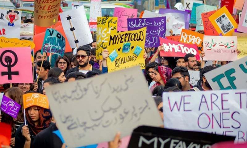 Aurat March participants holding placards on March 8. — Photo courtesy of Amnesty International
