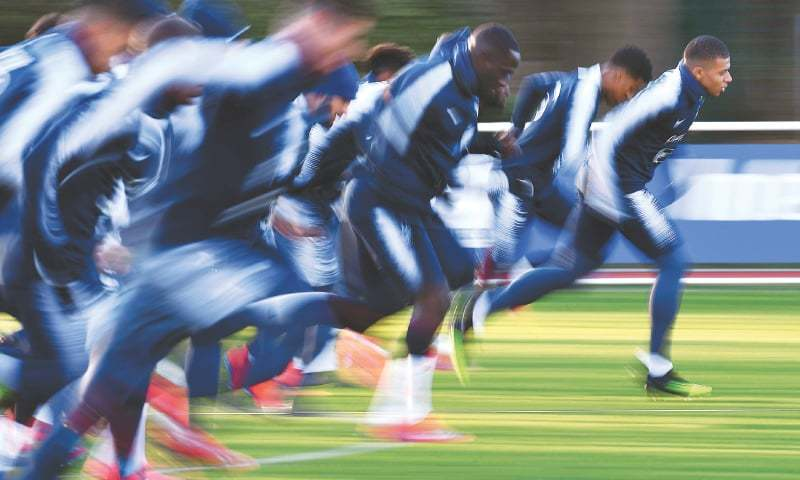 CLAIREFONTAINE: France's Kylian Mbappe (R) and team-mates run during a training session on Wednesday, as part of the squad's preparation for their upcoming Euro 2020 qualifiers against Moldova and Iceland.—AFP