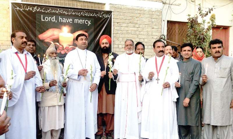 A vigil for victims of the attack on two mosques in New Zealand being held at All Saint's Church Kohati, Peshawar, on Wednesday. — Dawn