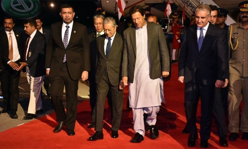 Malaysian premier Dr Mahathir Mohamad and Prime Minister Imran Khan at Nur Khan air base on March 21, 2019. — PID