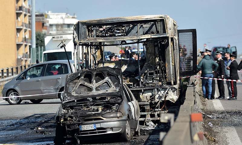 The wreckage of a school bus that was transporting some 50 children is pictured on March 20, 2019 after it was torched by the bus' driver, in San Donato Milanese, southeast of Milan. — AFP