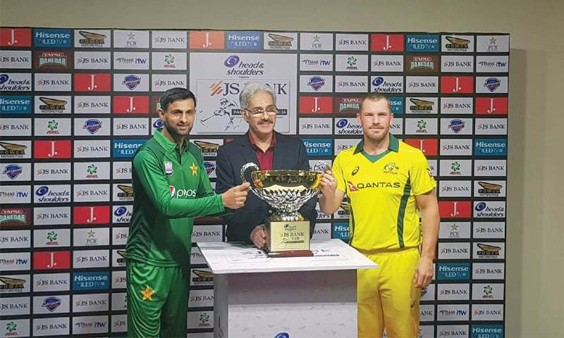 SHARJAH: Rivals captains Shoaib Malik of Pakistan and Australia's Aaron Finch hold the ODI series trophy at the Sharjah Cricket Stadium on Thursday. —Courtesy PCB