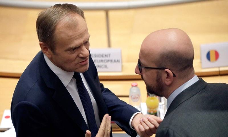 European Council President Donald Tusk (L) talks to Belgium's Prime Minister Charles Michel on March 22, 2019 in Brussels on the second day of an EU summit focused on Brexit. — AFP