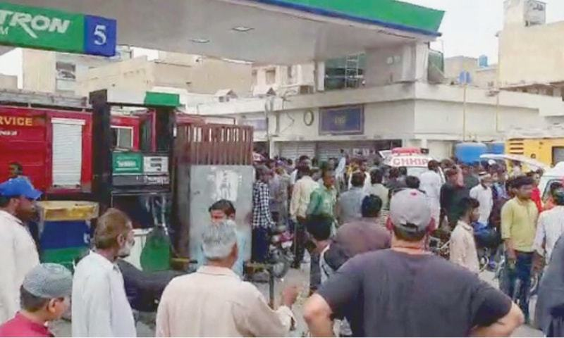 PEOPLE gather at the fuel station after the explosion on Sunday.—PPI