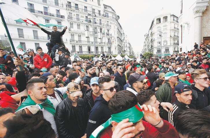 Algiers: People carry national flags during a protest calling on President Abdelaziz Bouteflika to quit.—Reuters