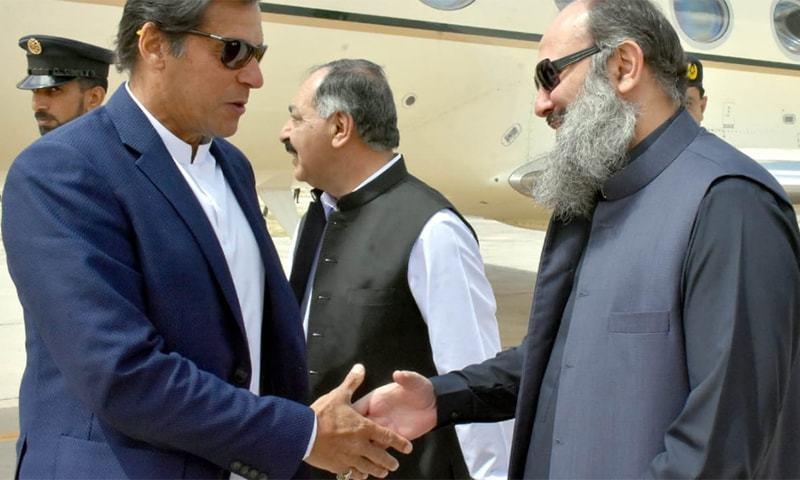 Prime Minister Imran Khan shakes hands with Balochistan Chief Minister Jam Kamal Alyani. ─ Photo courtesy Ghalib Nihad