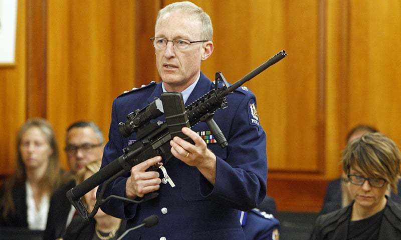 Police acting superintendent Mike McIlraith shows New Zealand lawmakers in Wellington on Tuesday an AR-15 style rifle similar to one of the weapons a gunman used to slaughter 50 people at two mosques. — AP