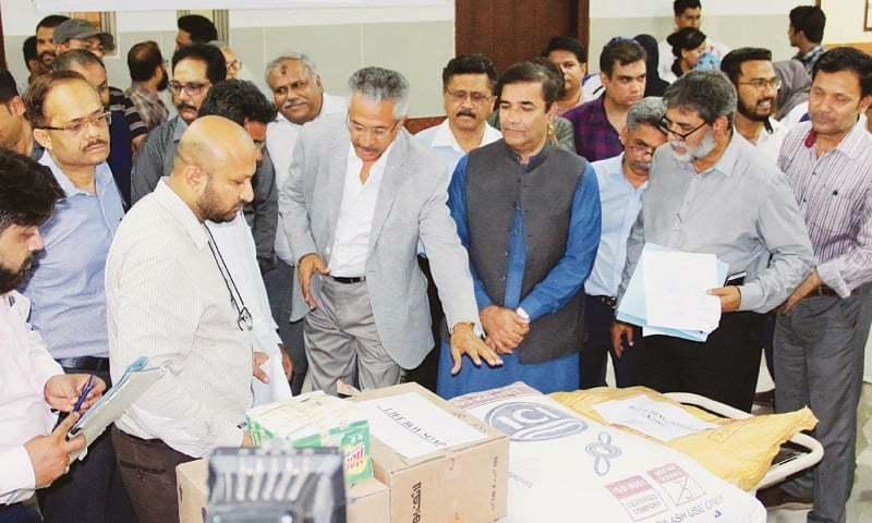 Mayor Wasim Akhtar with others  inspects medical instruments during his visit to the Abbasi Shaheed Hospital on Wednesday.—Online