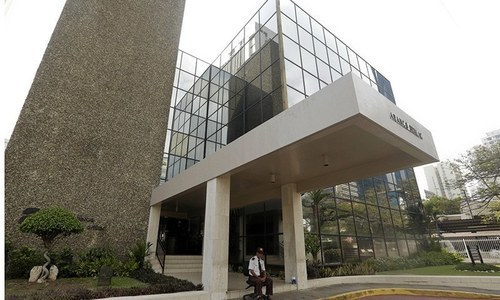 A security guard sit outside the Mossack Fonseca law firm in Panama City.— AP/File