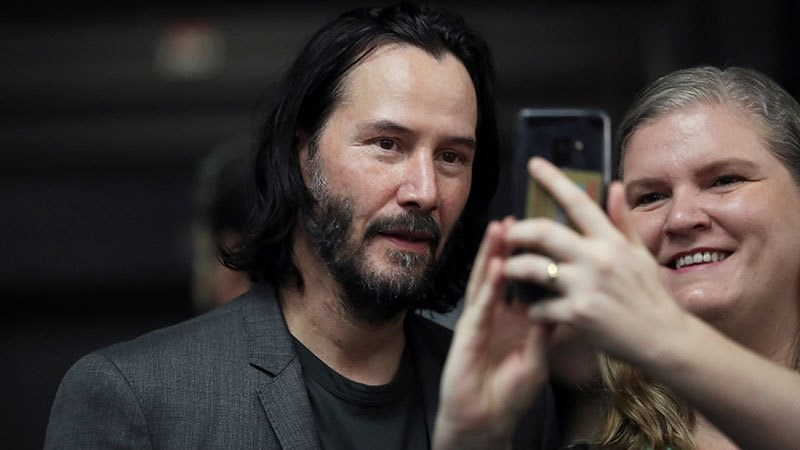 Actor and director Keanu Reeves takes a photo with a fan during a visit to Palacio dos Bandeirantes, seat of the Sao Paulo State Government, in Sao Paulo, Brazil, April 3, 2019. — Reuters