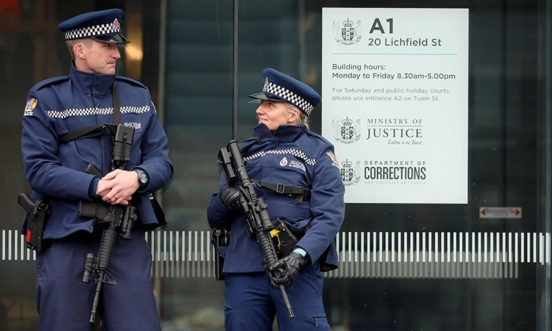 Armed police officers stand guard outside the Christchurch District Court in Christchurch on April 5, 2019. — AFP
