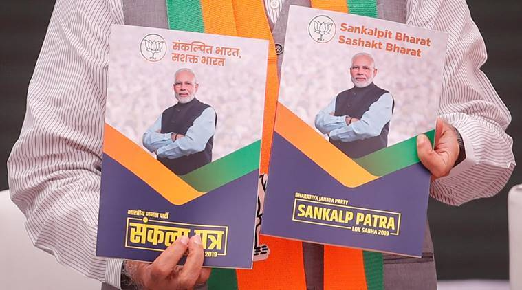 Indian Prime Minister Narendra Modi on Monday displays copies of BJP's election manifesto for the Lok Sabha elections. — Reuters