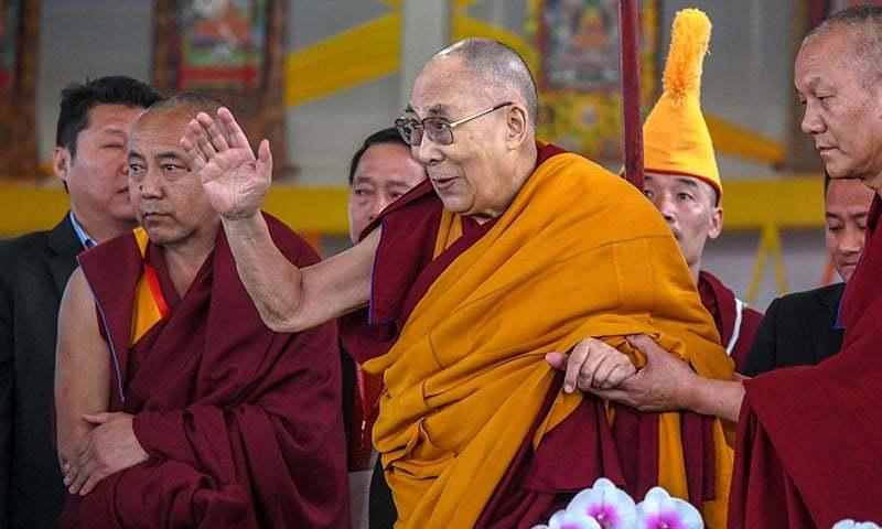 In this file photo taken on December 31, 2018, Tibetan spiritual leader the Dalai Lama (C) greets devotees at the closing ceremony of a teaching session at Kalachakra Ground in Bodhgaya. — AFP
