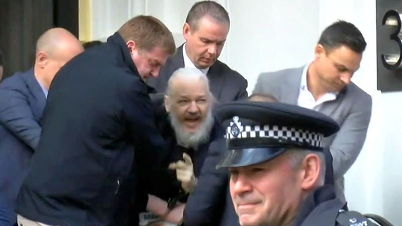 WikiLeaks founder Julian Assange bieng taken into custody at a central London police station. — Screengrab of footage shot by Ruptly