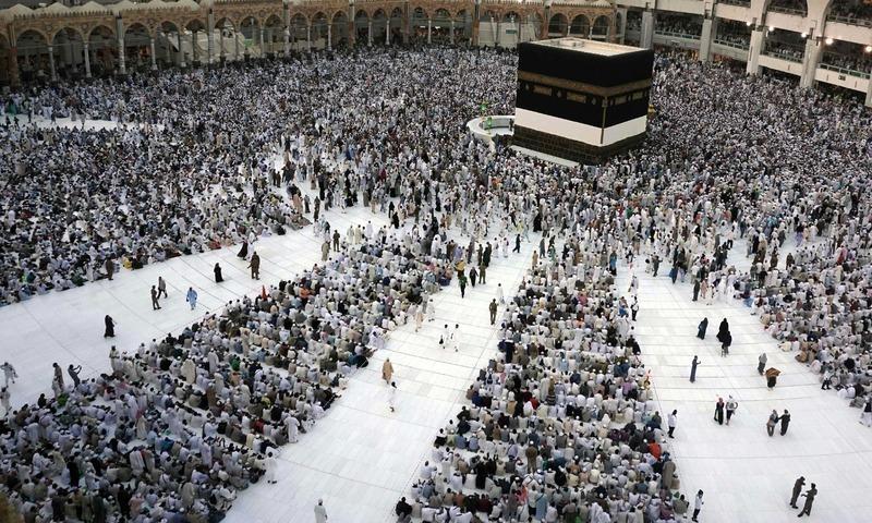 Pilgrims sit and circumambulate around the Kaaba ahead of the annual Haj pilgrimage in Makkah. — AFP/File