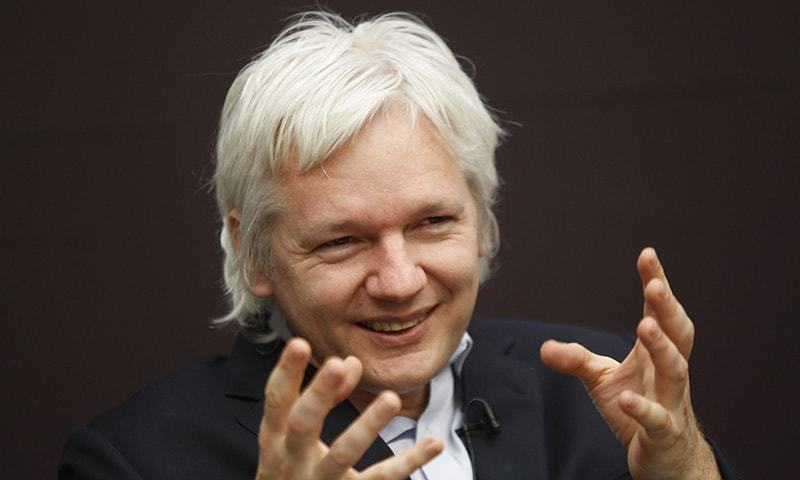 Wiki Leaks founder Julian Assange gestures as he speaks during a news conference in central London. — AP