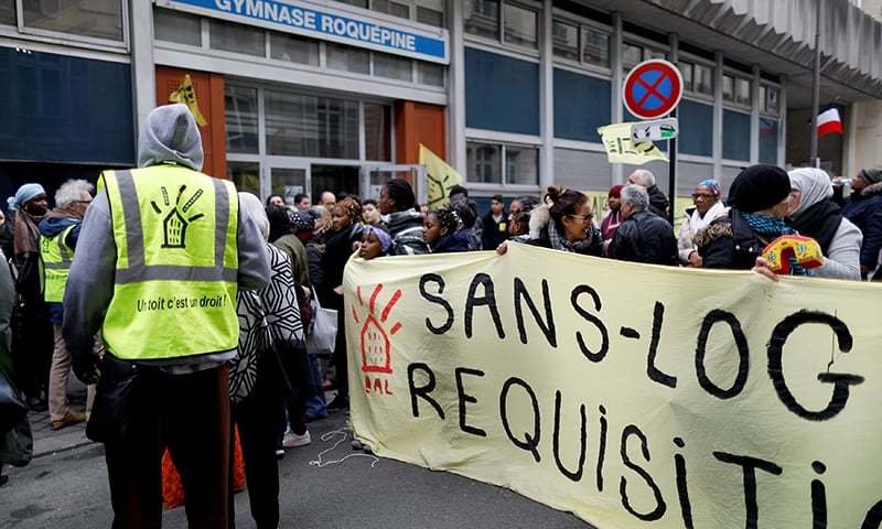 Right of Housing group DAL activists demonstrate during the visit of Leilani Farha, UN Special Rapporteur on the Right to Housing, at the gymnasium Roquepine occupied by dozens of homeless families. ─ Reuters