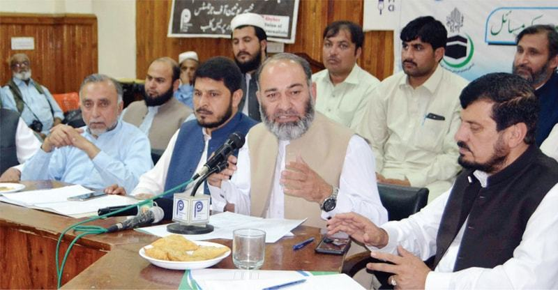 JI provincial chief Senator Mushtaq Ahmad Khan addresses the multiparty conference on BRT project at Peshawar Press Cub on Friday. — White Star