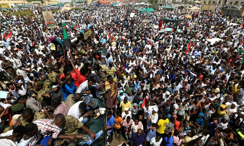 Khartoum: Sudanese demonstrators gather near the defence ministry on Friday as they protest against the army's announcement that President Omar al-Bashir would be replaced by a military-led transitional council.—Reuters