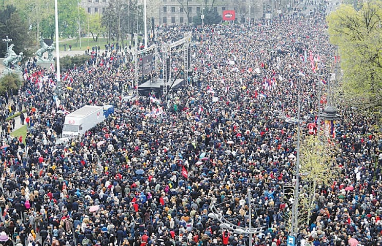 Belgrade: Demonstrators protest against Serbia's President Aleksandar Vucic and his government in front of the parliament building on Saturday. —Reuters