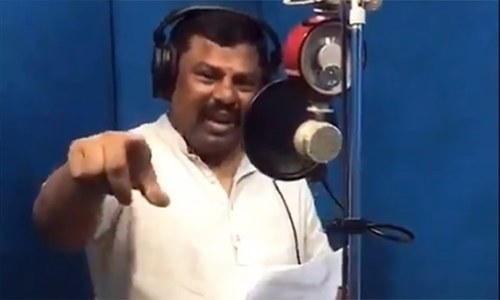 A screengrab from BJP MLA Raja Singh's Twitter shows him recording a song which is unmistakably similar to an ISPR anthem. — Twitter