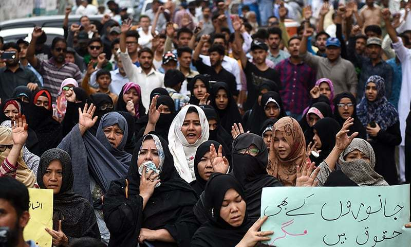 Protestors in Karachi shout slogans as they protest against the Friday blast at the Hazarganji vegetable and fruit market. — AFP