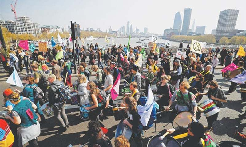 London: Environmental protesters from the Extinction Rebellion arrive at Waterloo Bridge for a demonstration. — AFP