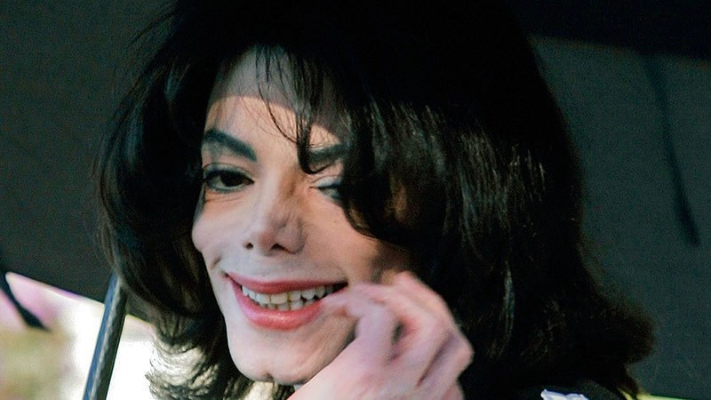 In this Dec 17, 2004, file photo, pop star Michael Jackson gestures after greeting several hundred children who were invited as guests at his Neverland Ranch home in Santa Ynez, California. — AP