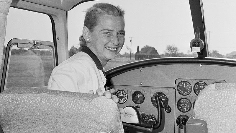 In this Oct 14, 1960 file photo, Jerrie Cobb sits in the cockpit of a twin engine Aero Commander airplane, as advertising and sales promotion manager of the plane's manufacturing company in Oklahoma City. — AP