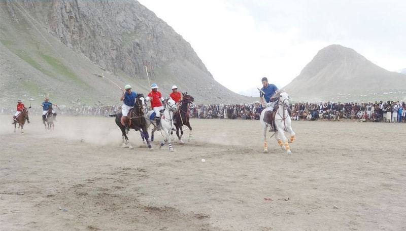 Final match of freestyle polo underway on the concluding day of Kagh Lusht festival in Upper Chitral on Sunday. ? Dawn