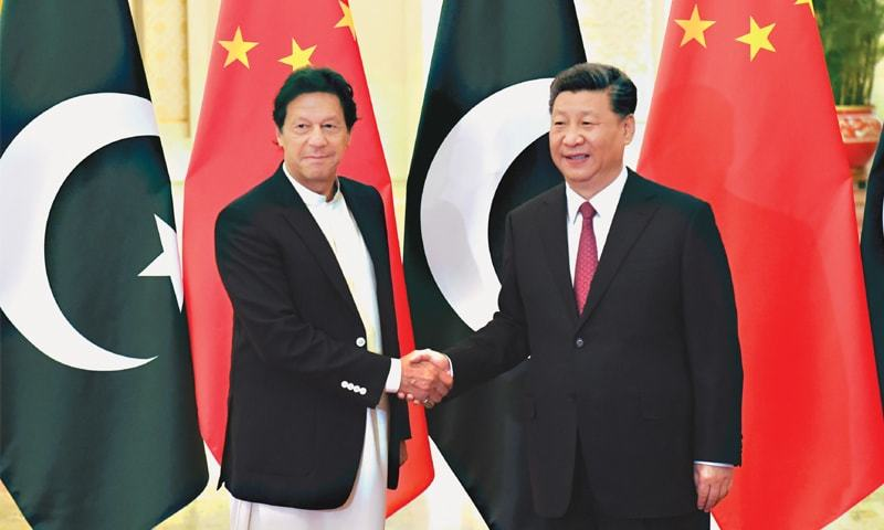 PRIME Minister Imran Khan shakes hands with President Xi Jinping before a meeting at the Great Hall of the People.—Reuters