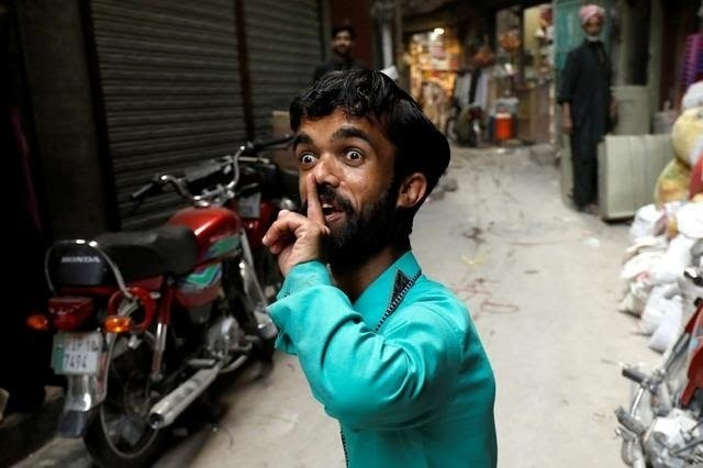 Rozi Khan, 26, a waiter and a lookalike of Hollywood's actor Peter Dinklage, who plays a character of Tyrion Lannister in the TV series ''Game of Thrones'', reacts on a street in Rawalpindi, April 28, 2019. - Reuters