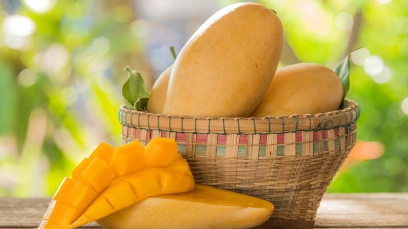 Fresh mango on the table. — Bigstock