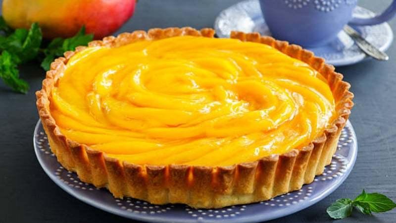 Tart with mango - stock image